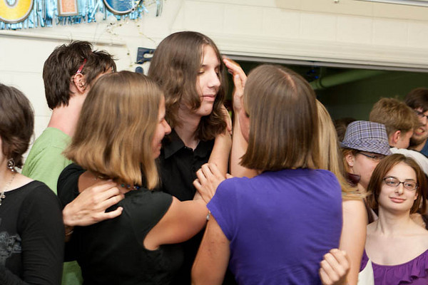Theo is mobbed by his sisters as the ceremony ends.