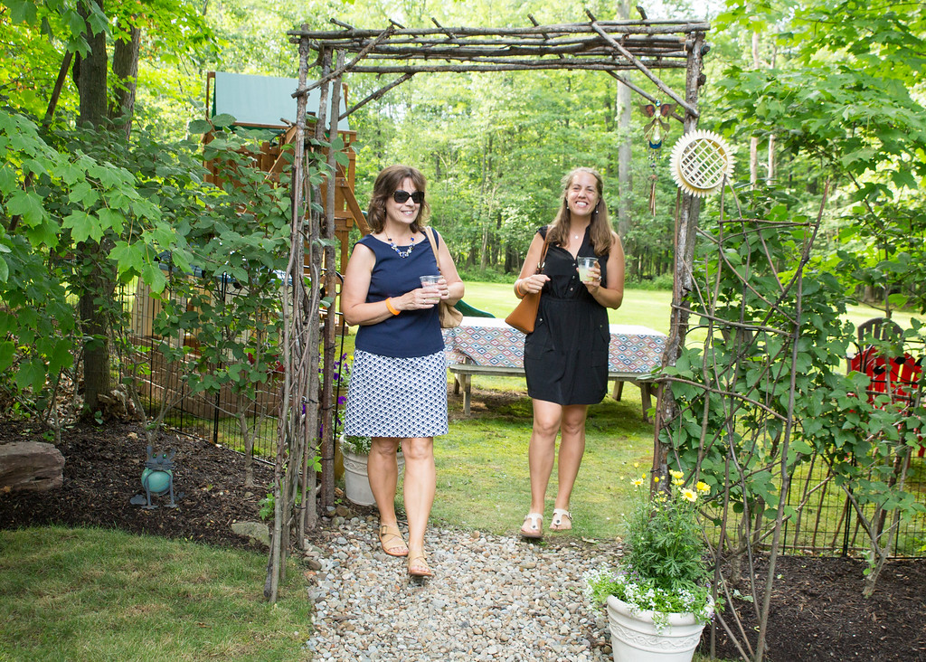 . Attendees enjoy the United Way of Lake County\'s first Solstice Garden Party. The event hosted by the Women\'s Leadership Council raised nearly $9,000 in support of women and girls in need. (courtesy Katherine Kurkov)