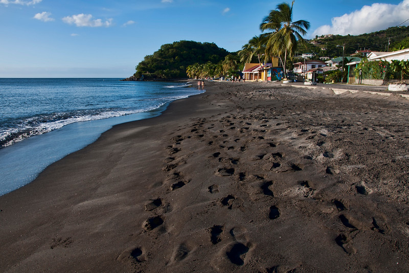 A view back to the village along the black sand beach.