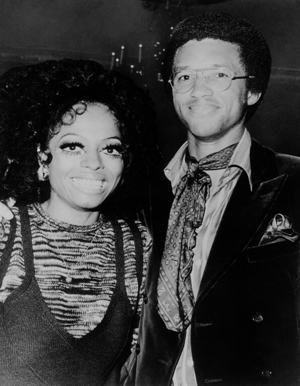 ". Singer Diana Ross, who made her New York debut as a solo act at the Waldorf Astoria Hotel on Wednesday, Sept. 10, 1970 in New York is shown at a party following the opening with Arthur Ashe, who swings a mighty tennis racket. Miss Ross had previously appeared with the singing group, ""The Supremes.\"" (AP Photo)"