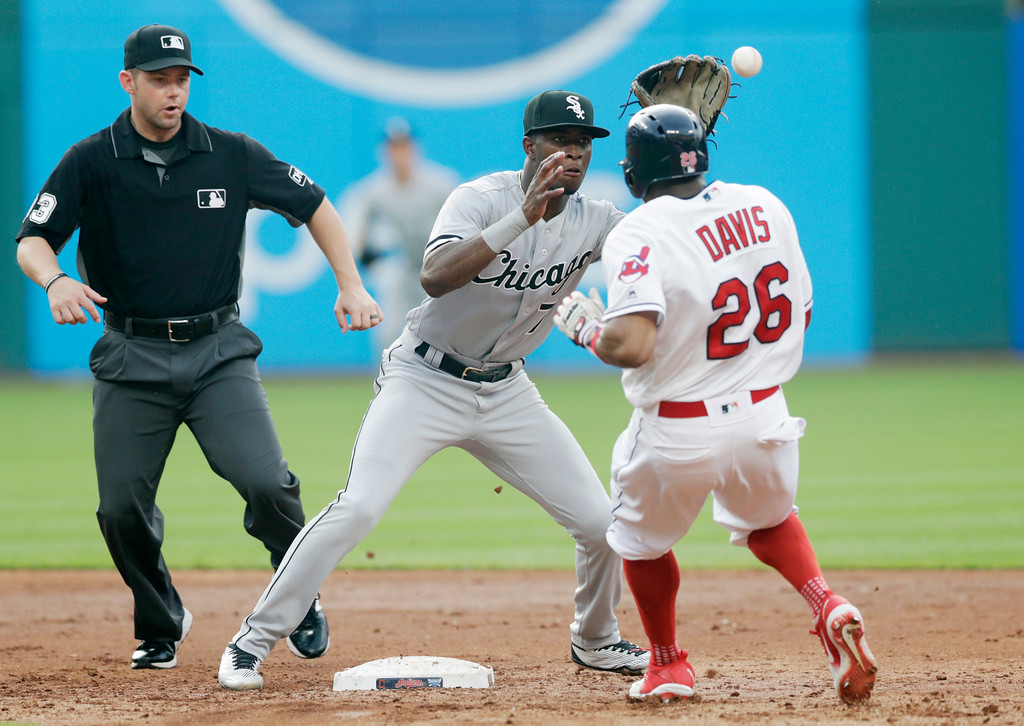 . Cleveland Indians\' Rajai Davis steals to second base as Chicago White Sox\'s Tim Anderson waits for the ball in the third inning of a baseball game, Monday, June 18, 2018, in Cleveland. Second base umpire Will Little watches. Davis was safe on the steal. (AP Photo/Tony Dejak)