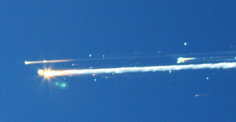 ". In this Feb. 1, 2003 file photo, debris from the space shuttle Columbia streaks across the sky over Tyler, Texas. The Columbia broke apart in flames 200,000 feet over Texas on Saturday, killing all seven astronauts just minutes before they were to glide to a landing in Florida.  Ten years later, reminders of Columbia are everywhere, including up in the sky.  Everything from asteroids, lunar craters and Martian hills, to schools, parks, streets and even an airport (Rick Husband Amarillo International Airport) bear the Columbia astronauts\' names. Two years ago, a museum opened in Hemphill, Texas, where much of the Columbia wreckage rained down, dedicated to ""remembering Columbia.\""  About 84,000 pounds of that wreckage, representing 40 percent of NASA\'s oldest space shuttle, are stored at Kennedy and loaned for engineering research.  (AP Photo/Scott Lieberman)"