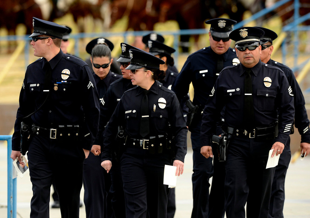 . Members of the Los Angeles Police Department enter memorial services for San Bernardino County Sheriff Deputy Jeremiah MacKay at the San Manuel Amphitheater in Devore February 21, 2013.  GABRIEL LUIS ACOSTA/STAFF PHOTOGRAPHER.
