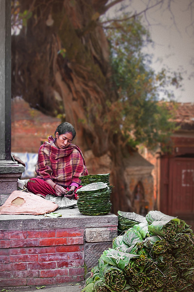 Young Woman Making Leaf Plates