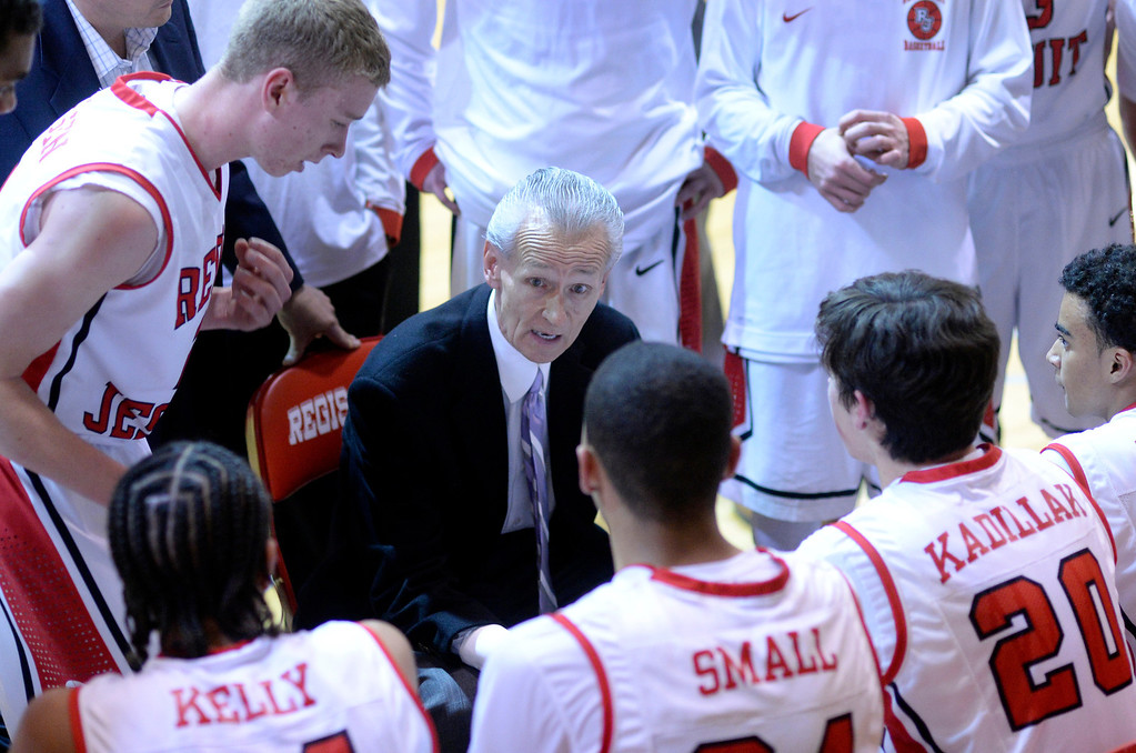 . Regis coach Ken Shaw talked to the boys after an impressive run in the first quarter. The Regis Jesuit High School boy\'s basketball team defeated Highlands Ranch 63-54 Tuesday night, February 4, 2014. Photo By Karl Gehring/The Denver Post