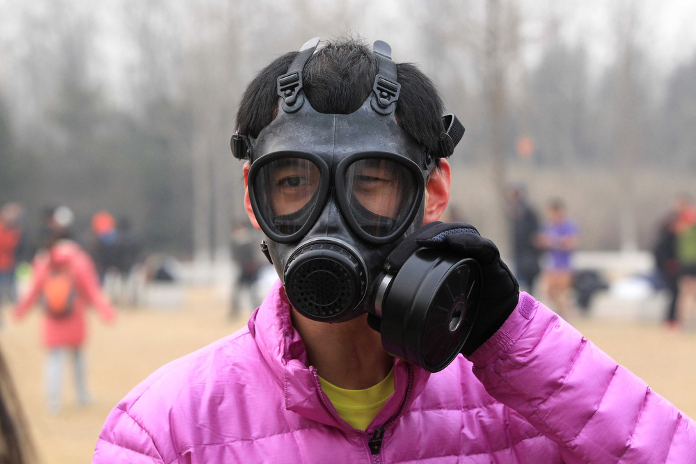 Description of . This picture taken on February 24, 2013 shows a man wearing a gas mask during the annual 3.5 km Undie Run held in the Olympic Forest Park in Beijing. Some 300 participants wanted to prove that Chinese can brave the cold just as well as any nationality and promote nationwide fitness. There were no winners, no trophies and no starting gun or finishing line. AFP PHOTOAFP/AFP/Getty Images