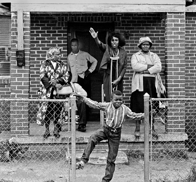Negro woman with crutches waving, with young boy and older women watching marchers - 1965 Selma to Montgomery, Alabama Civil Rights March - March 25, 1965