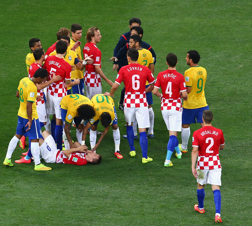 . Neymar of Brazil speaks to referee Yuichi Nishimura after a foul in the first half as Luka Modric of Croatia lies on the field during the 2014 FIFA World Cup Brazil Group A match between Brazil and Croatia at Arena de Sao Paulo on June 12, 2014 in Sao Paulo, Brazil.  (Photo by Kevin Cox/Getty Images)