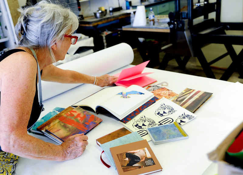 Barbra Riley lays out books bound by her students.