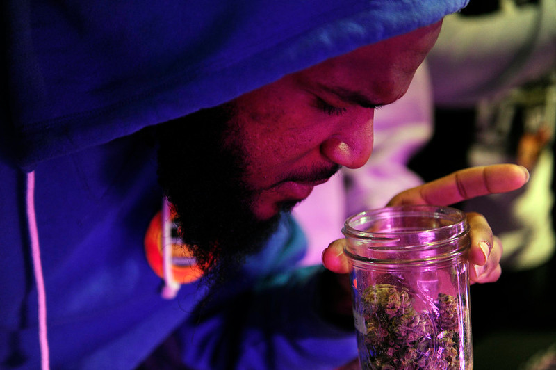 . A marijuana enthusiast who asked not to be named takes a whiff of Sour Kush at the Black Dog LED booth during the final day of the first ever High Times US Cannabis Cup at the Exdo Center in Denver on Sunday, April 21, 2013. Seth A. McConnell, The Denver Post