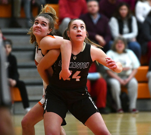 2/14/2020 Mike Orazzi | StaffrTerryville High School's Taylor Barnett (14) and Thomaston's Emma Sanson (24) during Friday evening's girls basketball game in Terryville. r