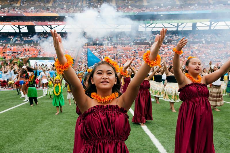 . Hula dancers perform before the NFL Pro Bowl football game in Honolulu, Sunday, Jan. 27, 2013. (AP Photo/Marco Garcia)