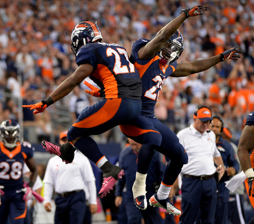 . Running back Knowshon Moreno #27 of the Denver Broncos celebrates his touchdown with running back Ronnie Hillman #21. (Photo By Joe Amon/The Denver Post)
