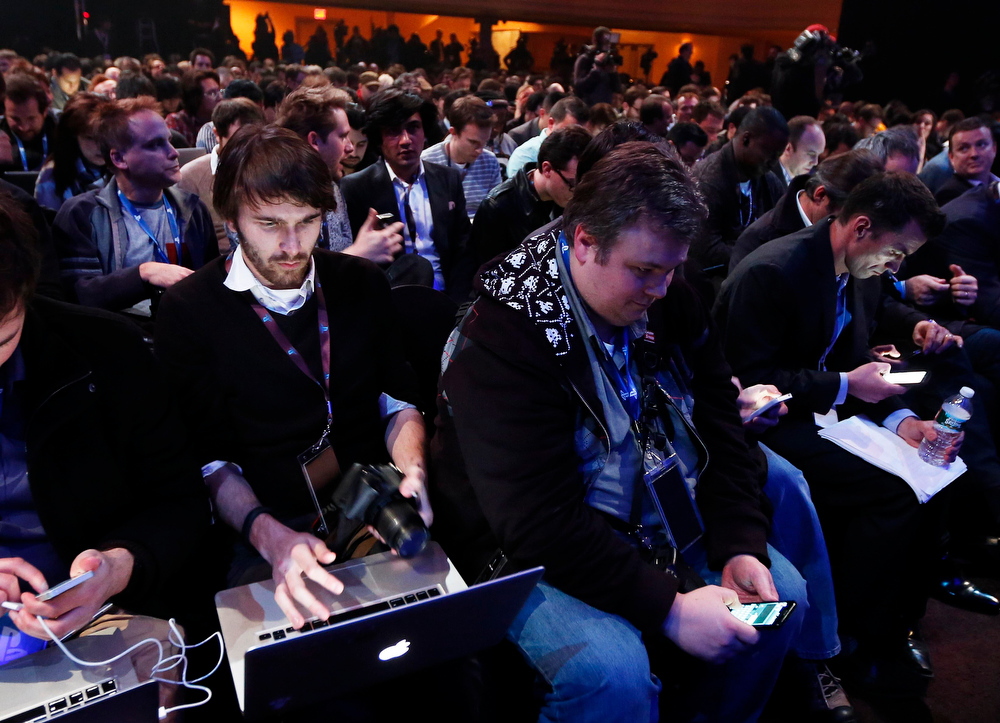 . People are seated before the unveiling of the PlayStation 4 launch event in New York, February 20, 2013. Sony Corp is expected to showcase a new PlayStation console on Wednesday in a pre-emptive strike against Microsoft Corp\'s bid to make its Xbox the world\'s leading hub for household entertainment. REUTERS/Brendan McDermid