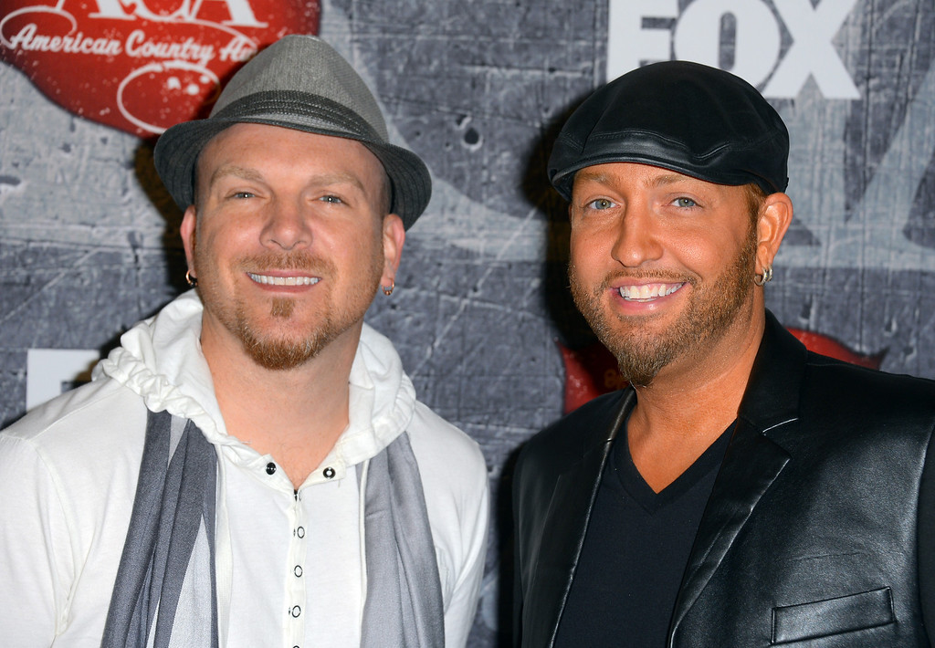 . LAS VEGAS, NV - DECEMBER 10:  Recording artists Chris Lucas (L) and Preston Brust of the LoCash Cowboys arrive at the 2012 American Country Awards at the Mandalay Bay Events Center on December 10, 2012 in Las Vegas, Nevada.  (Photo by Frazer Harrison/Getty Images)