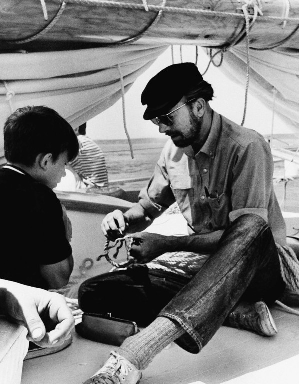 . Folk singer Pete Seeger aboard his brainchild, the sloop Clearwater, cruising on Aug. 12, 1969, down from Massachusetts to N.Y., on Madrid voyage. (AP Photo)