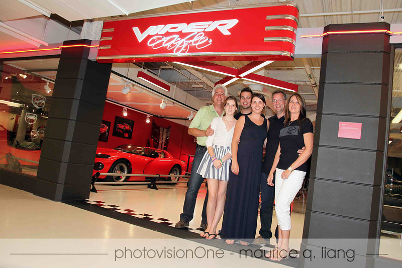 Mansen Way, who created and donated the Viper Cafe signs, poses with his family in front of the cafe.