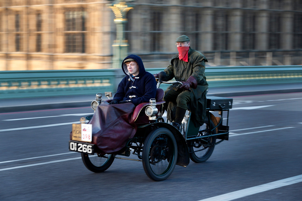 . Backdropped by the Houses of Parliament in central London, participants drive their 1904 Lagonda car during the London to Brighton Veteran Car Run, Sunday, Nov. 3, 2013. Over 400 pre-1905 vehicles made their way on the historic 60-mile run from Hyde Park in London to coastal Brighton in southern England, in the world\'s longest running motoring celebration spanning 117 years.(AP Photo/Lefteris Pitarakis)