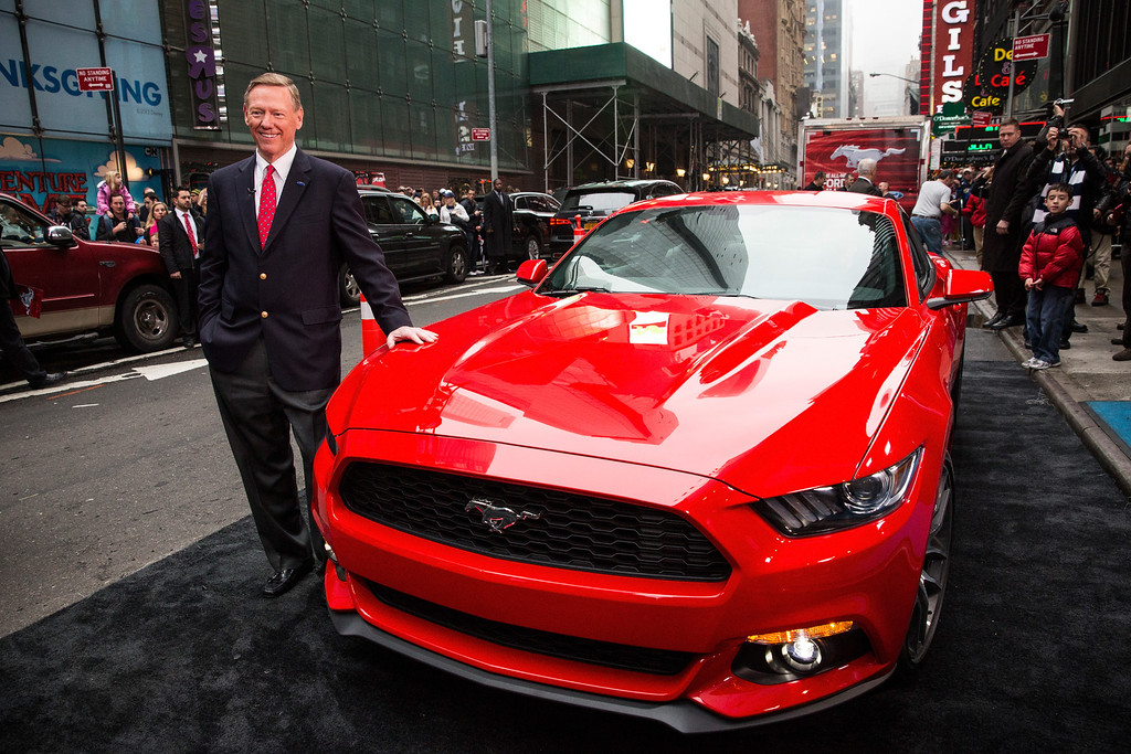 . Alan Mulally, CEO of Ford, poses next to the 2015 Ford Mustang on the set of Good Morning America on December 5, 2013 in New York City. The 2015 model marks the 50th anniversary of the Ford Mustang line.  (Photo by Andrew Burton/Getty Images)