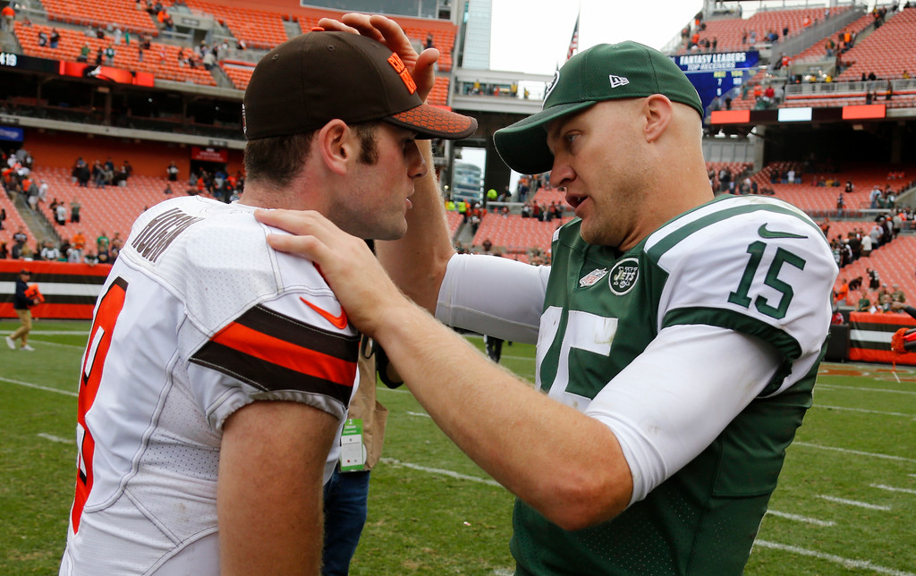 . New York Jets quarterback Josh McCown (15) talks with Cleveland Browns quarterback Kevin Hogan (8) after an NFL football game, Sunday, Oct. 8, 2017, in Cleveland. (AP Photo/Ron Schwane)