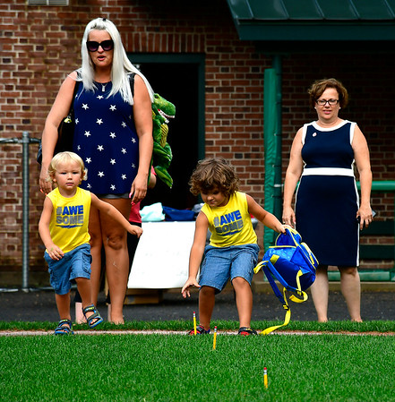 8/22/2019 Mike Orazzi | Staff Brittany Rabis looks on as her children Xander and Zane participate in the second annual Mayors Back to School Pencil Hunt held at Muzzy Field in Bristol on Thursday evening.