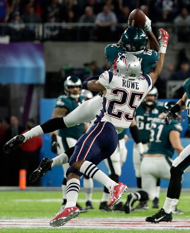 . Philadelphia Eagles wide receiver Torrey Smith (82), makes a catch against New England Patriots cornerback Eric Rowe (25), during the first half of the NFL Super Bowl 52 football game, Sunday, Feb. 4, 2018, in Minneapolis. (AP Photo/Frank Franklin II)