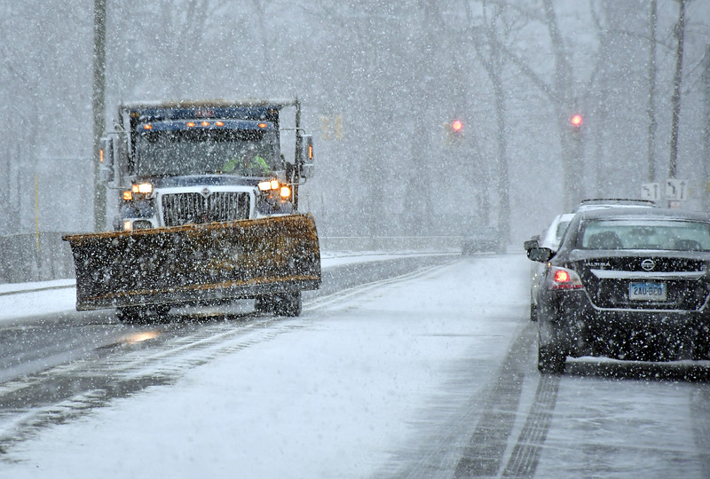 1/18/2020 Mike Orazzi | Staff A city of Bristol snowplow out during Saturday's snow storm on South Street.