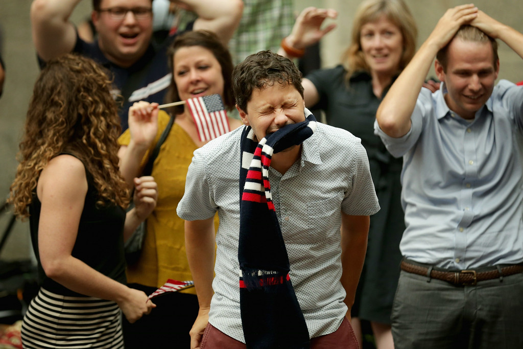 . Fans react after watching the U.S. lose to Belgium in the World Cup during a viewing party in the Kogod Courtyard of the Smithsonian National Portait Gallery July 1, 2014 in Washington, United States. Belgium won the match 2-1.  (Photo by Chip Somodevilla/Getty Images)