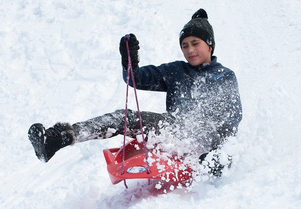 12/03/19 Wesley Bunnell | StaffrrJayvian Graci-Rivera sled down a hill at Smith Elementary School on Tuesday December 3, 2019.