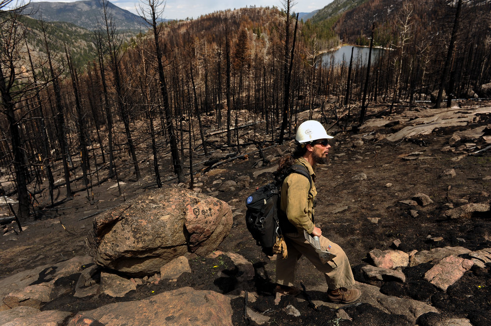 . Mark Mendonca, a Captain with the Alpine Hotshots, hikes through burned areas of the Fern Lake fire along the Cub Lake trail in Rocky Mountain National Park on May 13, 2013.   (Photo by Helen H. Richardson/The Denver Post)