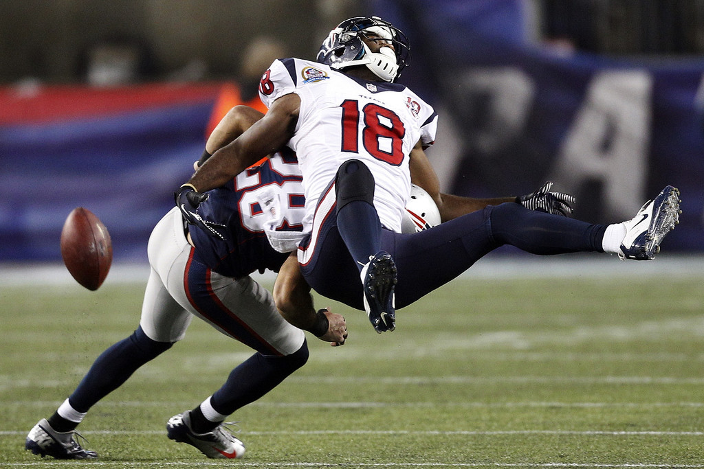 . New England Patriots strong safety Steve Gregory (28) breaks up a pass intended for Houston Texans wide receiver Lestar Jean (18) during the second quarter of an NFL football game in Foxborough, Mass., Monday, Dec. 10, 2012. (AP Photo/Stephan Savoia)