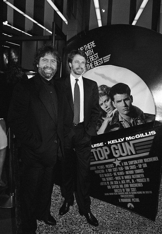 ". Don Simpson, left, and Jerry Bruckheimer, right, the Executive Producers of the movie, ""Top Gun\'\"" stand outside the Cinema 1 Theater in San Diego, Calif., Thursday night for the West Coast premier of the movie, May 15, 1986. (AP Photo/Ken Levine)"
