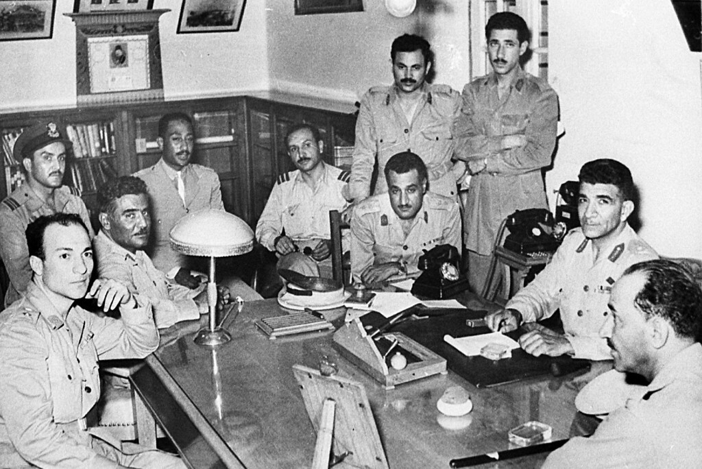 ". CAIRO, EGYPT - 1952:  Meeting of the Egyptian ""Free Officers\"" in Cairo in 1952. The Free Officers forced King Faruq 23 July 1952 to leave the throne and replaced him by his son King Fouad. Mohammed Nagib (2R) Gamal Abdel Nasser (3R) Anwar al-Sadat (From 4L). Others are unidentified. (Photo by AFP/Getty Images)"