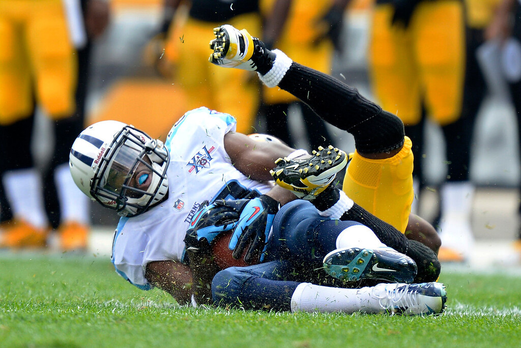 . Tennessee Titans cornerback Alterraun Verner, front, intercepts a pass intended for Pittsburgh Steelers wide receiver Emmanuel Sanders in the second quarter of an NFL football game on Sunday, Sept. 8, 2013, in Pittsburgh. (AP Photo/Don Wright)