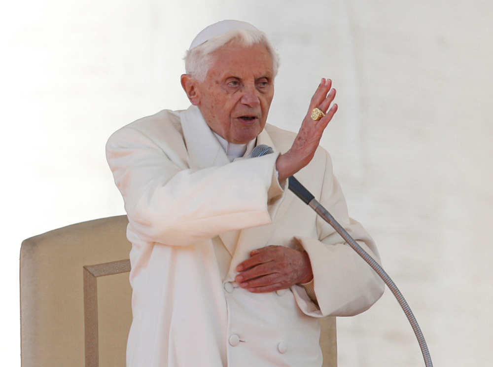 Description of . Pope Benedict XVI blesses the crowd at the end of his last general audience in St Peter\'s Square at the Vatican February 27, 2013. The weekly event which would normally be held in a vast auditorium in winter, but has been moved outdoors to St. Peter\'s Square so more people can attend. The pope has two days left before he takes the historic step of becoming the first pontiff in some six centuries to step down instead of ruling for life.           REUTERS/Alessandro Bianchi