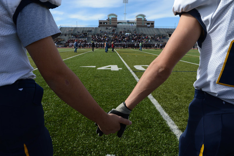 . Rifle players hold hands before the start of the Class 3A Championship football game, Saturday December 01, 2012.  The Silver Creek Raptors beat  the Rifle Bears 32 - 15 at Legacy Stadium in Aurora, CO. Craig F. Walker, The Denver Post
