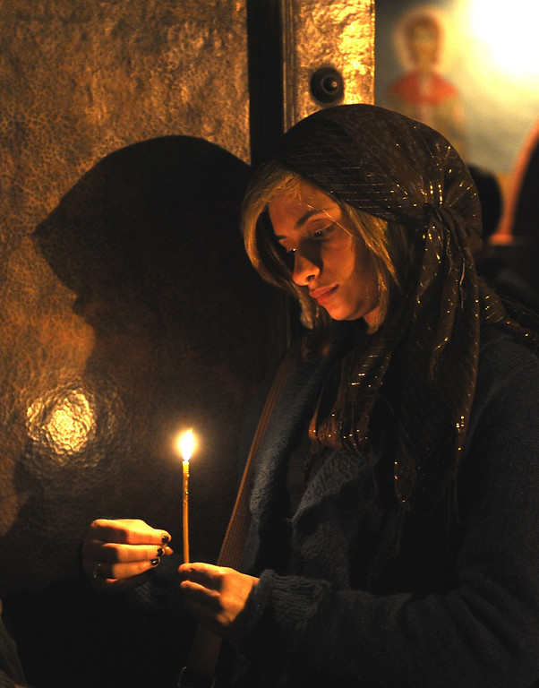 . Georgian Orthodox believers attend a service as they celebrate an Orthodox Easter in a church in Tbilisi early on April 20, 2014.  AFP PHOTO / VANO SHLAMOV/AFP/Getty Images