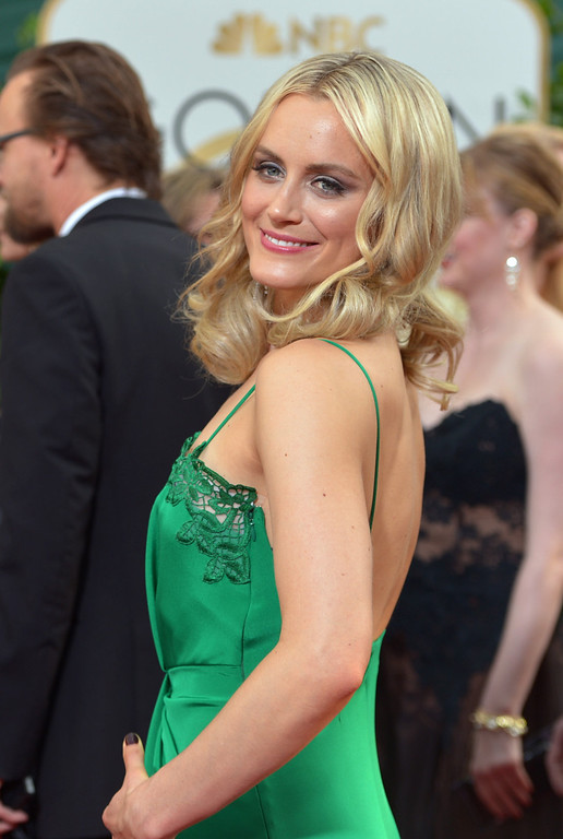 . Taylor Schilling arrives at the 71st annual Golden Globe Awards at the Beverly Hilton Hotel on Sunday, Jan. 12, 2014, in Beverly Hills, Calif. (Photo by John Shearer/Invision/AP)