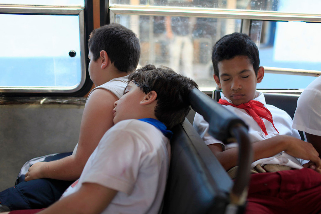 . Students who have autism sleep on the bus home after a school field trip to the zoo in Havana, Cuba on May 9, 2013. The Dora Alonso school caters to the education of children with autism and is paid for by the state.  (AP Photo/Franklin Reyes)