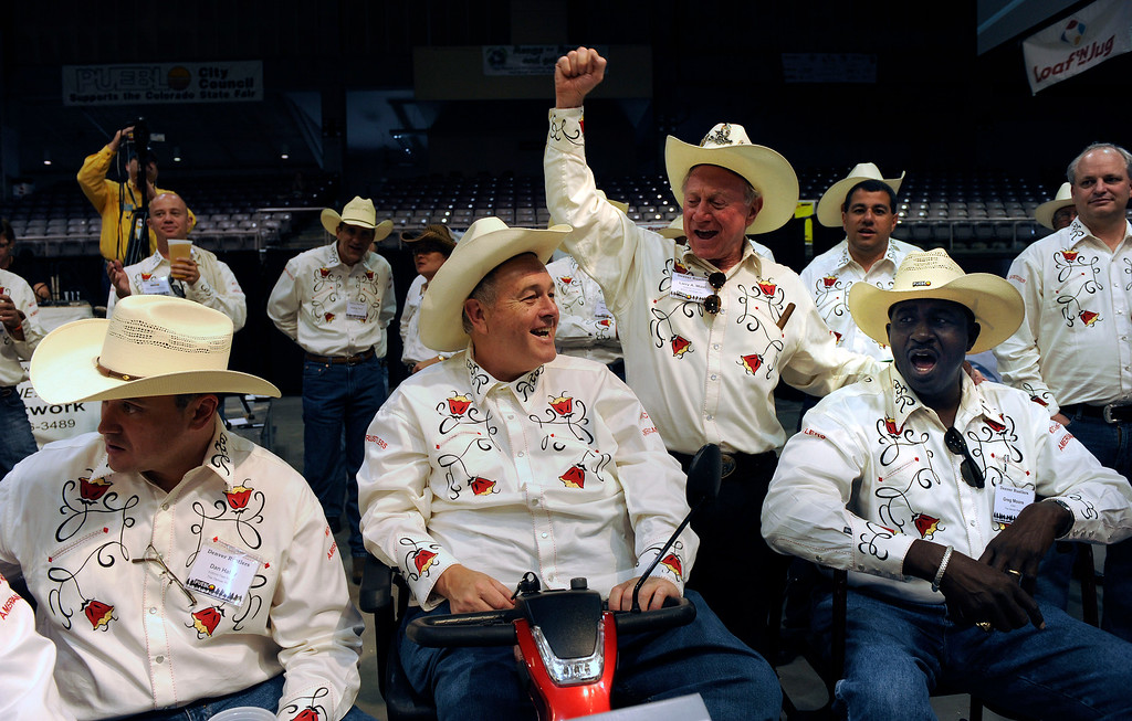 . ABOVE: Dean Singleton, publisher of the Denver Post , second from left and Larry Mizel, Chairman and CEO of M.D.C Holdings and Denver Post Editor Greg Moore, celebrate the buying of both this year\'s Grand Reserve champion steer for $19,000 and the Champion Lamb for $10,000. The 138th Colorado State Fair continues at the Colorado State Fairgrounds today August 31, 2010.  The fair ends Monday September 6th. Helen H. Richardson&fras1; The Denver Post