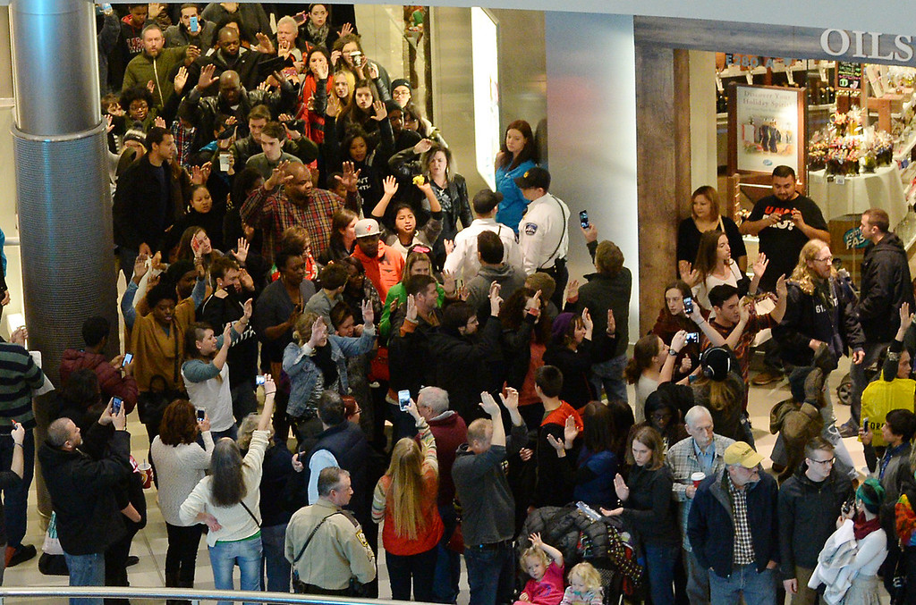 . Demonstrators march through the Mall of America. (Pioneer Press: John Autey)
