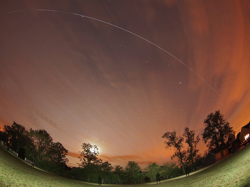 June 14/15 2011. Yet again another amazing marathon night of multiple ISS flybys across UK skies. What a month! This time the ISS flew over 5 times, however light/cloud precluded a few of these from sight. This from the 0048hrs Flyby. Captured with Oly E5 & 8mm fisheye.  Camera settings: 15s exposures shot continuous during flyby, ISO 500, F3.5. Foreground lit with a few flash bursts away from camera.