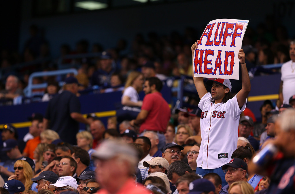 . A Boston Red Sox fan holds up a sign in the crowd during Game Three of the American League Division Series against the Tampa Bay Rays at Tropicana Field on October 7, 2013 in St Petersburg, Florida.  (Photo by Mike Ehrmann/Getty Images)