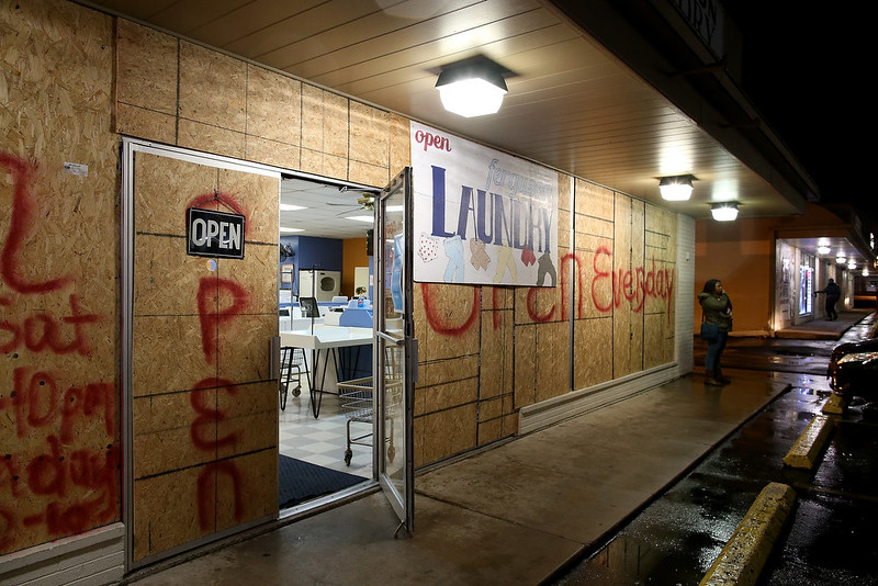 . A boarded up business is seen open on November 22, 2014 in Ferguson, Missouri. Tensions in Ferguson remain high as a grand jury is expected to decide soon if Ferguson police officer Darren Wilson should be charged in the shooting death of Michael Brown.  (Photo by Justin Sullivan/Getty Images)