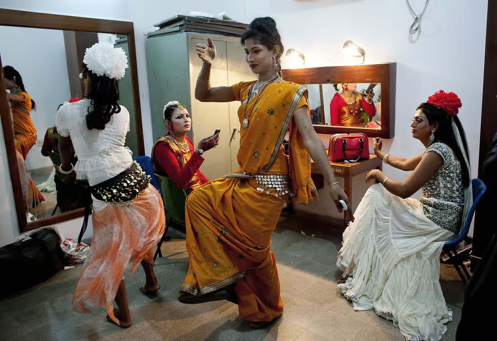 . Hijras (transgender) dance as they get ready backstage before the Hijra talent show, part of the first ever event called Hijra Pride 2014, on November 10, 2014 in Dhaka, Bangladesh.  In 2013 Bangladesh officially recognized Hijras as a third gender, though homosexuality still remains illegal. Despite these strides Hijras continue to face violence and harassment as part of their daily life in Bangladesh. (Photo by Allison Joyce/Getty Images)