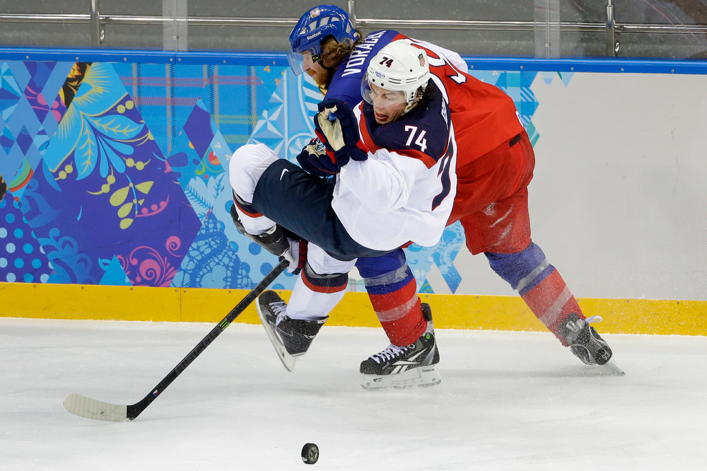 . USA forward T.J. Oshie looses his footing under pressure from Czech Republic forward Ales Hemsky during the second period of men\'s quarterfinal hockey game in Shayba Arena at the 2014 Winter Olympics, Wednesday, Feb. 19, 2014, in Sochi, Russia. (AP Photo/Matt Slocum)