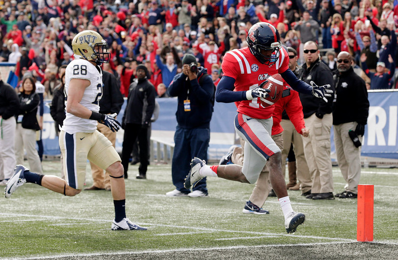 . Mississippi wide receiver Vince Sanders (10) scores a touchdown as Pittsburgh defensive back Anthony Gonzalez (28) pursues during the first half of the BBVA Compass Bowl NCAA college football game at Legion Field in Birmingham, Saturday, Jan. 5, 2013. (AP Photo/Dave Martin)