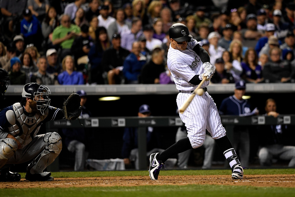. Brandon Barnes (1) of the Colorado Rockies gets a hold of one  for a double against the San Diego Padres at Coors Field. April 09, 2016 in Denver, CO. (Photo By Joe Amon/The Denver Post)