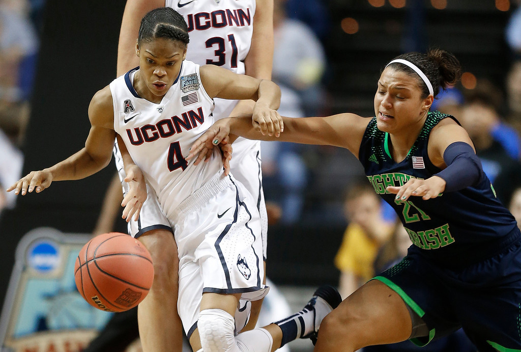 . Notre Dame guard Kayla McBride (21) and Connecticut guard Moriah Jefferson (4) vie for a loose ball during the second half of the championship game in the Final Four of the NCAA women\'s college basketball tournament, Tuesday, April 8, 2014, in Nashville, Tenn. (AP Photo/John Bazemore)