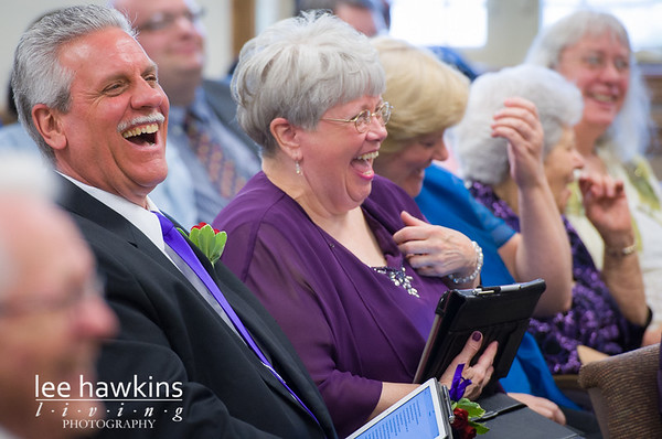 Friends laughing during wedding ceremony